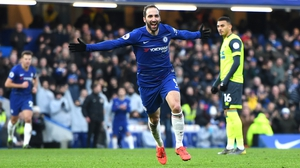 Gonzalo Higuain celebrates as he scores on his first Chelsea goals