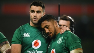Conor Murray consoles Bundee Aki after the defeat to England
