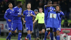 Cardiff players hold aloft an image of missing striker Emiliano Sala after going 1-0 up
