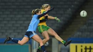 Donegal's Karen Guthrie scores a point despite pressure from Dublin defender Martha Byrne at Croke Park