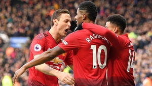Manchester United players celebrate their goal
