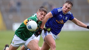 Kerry's Killian Spillane gets to the ball ahead of Cavan's Padraig Faulkner