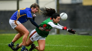 Mayo's Noirin Moran fights for the ball with Laura Dillon of Tipperary