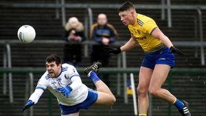 Conor Cox in action against Monaghan's drew Wylie