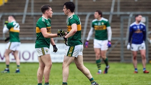 Kerry players celebrate their three-point win in Cavan