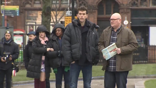 Mark Charnock and Dominic Brunt filming in Belfast, screengrab via ITV News