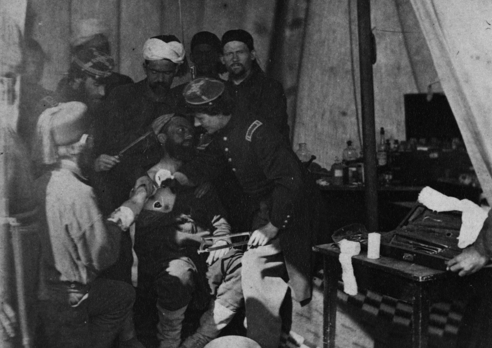 Image - French solders tending to an injured colleague in 1863. Photo: George Stacy/Buyenlarge/Getty Images