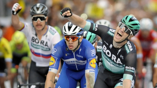 Sam Bennett (R)punches the air in celebration after winning the final stage of the Vuelta a San Juan Internacional