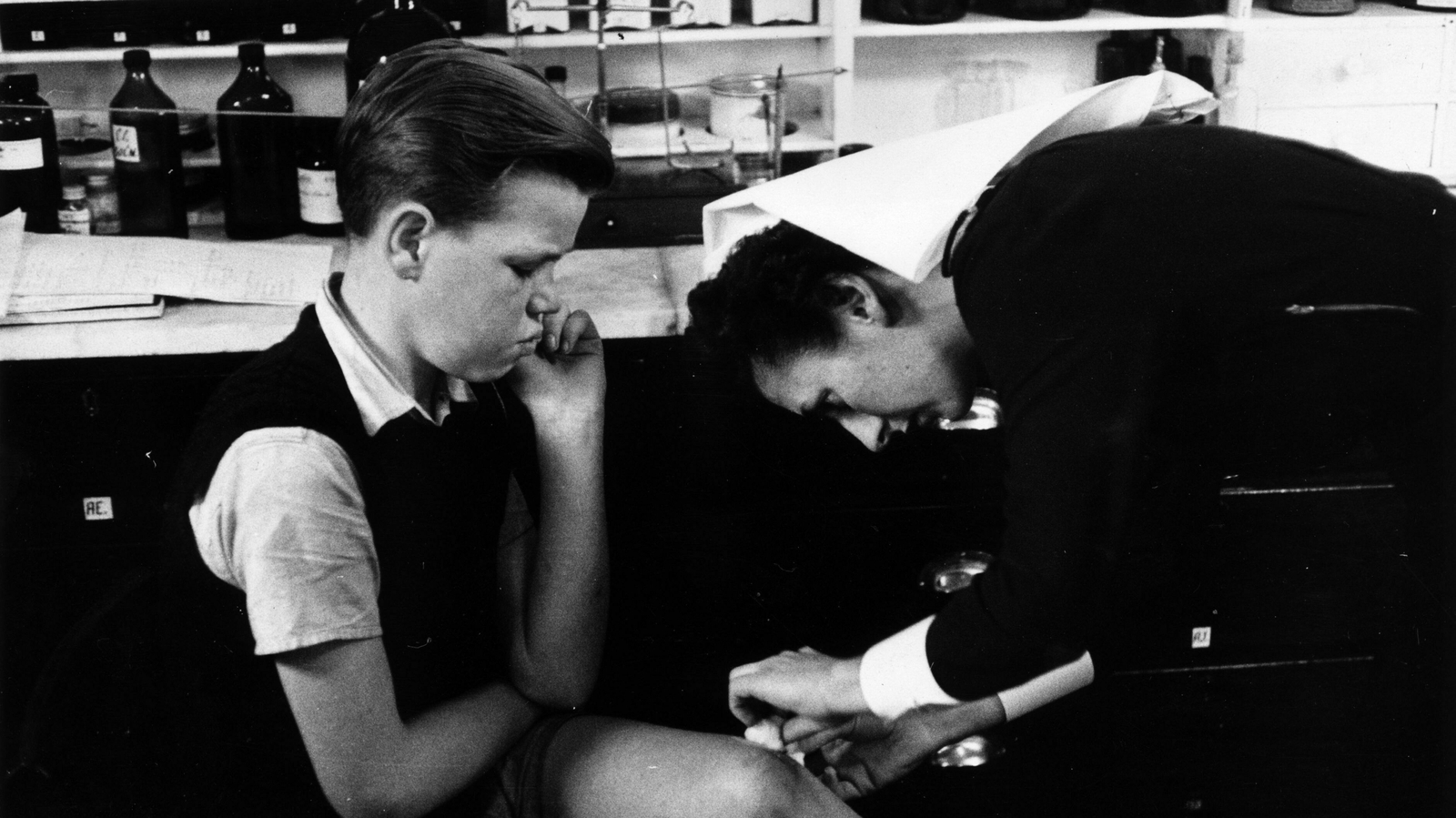 Image - A ship's nurse attending to a stowaway in 1956.  Photo: Bert Hardy/ Picture Post/Getty Images