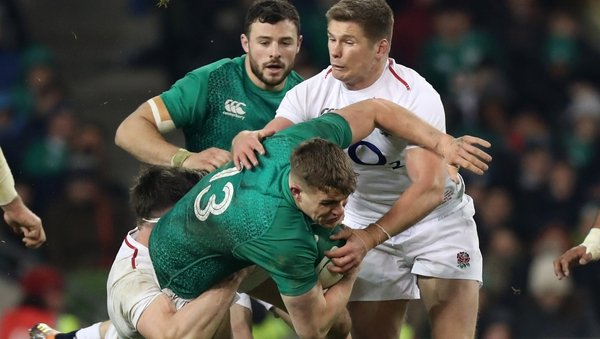Garry Ringrose is tackled by England's Tom Curry and Owen Farrell