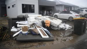 Wrecked and destroyed household items lie outside a home in the suburb of Rosslea after flood waters receded in Townsville
