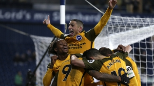 Glenn Murray of Brighton & Hove Albion celebrates with his team mates