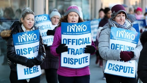 Nurses take part in their third day of industrial action over pay and conditions outside the Mater Hospital in Dublin