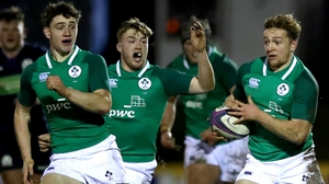 Ireland's Liam Turner is backed up by Cormac Foley and David Hawkshaw