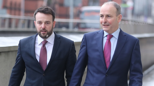 Colum Eastwood (L) and Micheál Martin at a previous meeting in January