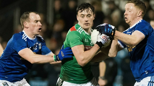 Diarmuid O'Connor is tackled by Martin Reilly and Jack Brady