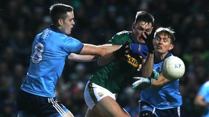 Kerry's Gavin O'Brien tackled by Brian Fenton and Michael Fitzsimons