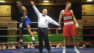 Gabriel Dossen (Blue) celebrates his victory over Michael Nevin