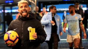 Sergio Aguero has a cheeky celebration for the camera after firing in a hat-trick against Chelsea