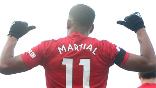 Anthony Martial celebrates his fine solo goal at Fulham