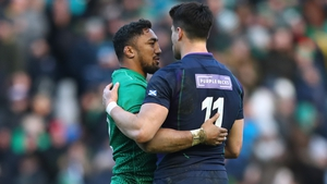 Bundee Aki and Seán Maitland embrace after the full-time whistle at BT Murrayfield