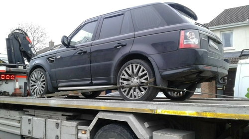 The seized vehicles include a Range Rover and an Audi A6