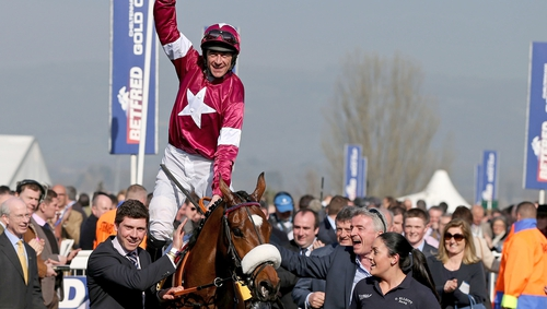 Davy Russell celebrates winning the 2018 Grand National on Tiger Roll