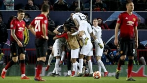 United players look on as PSG celebrate