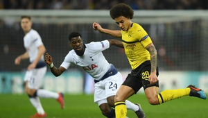 Axel Witsel of Borussia Dortmund is challenged by Serge Aurier
