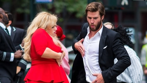 Rebel Wilson dancing with Liam Hemsworth on set