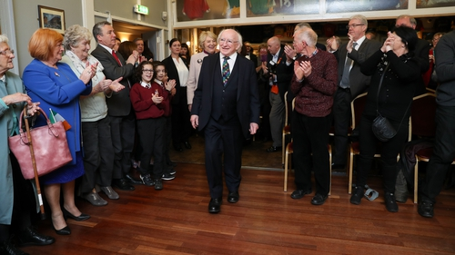 The crowd rose to their feet in applause as President Higgins and Sabina arrived