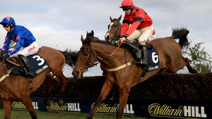 Robinsfirth and Sean Bowen (right) clear a hurdle on their way to victory