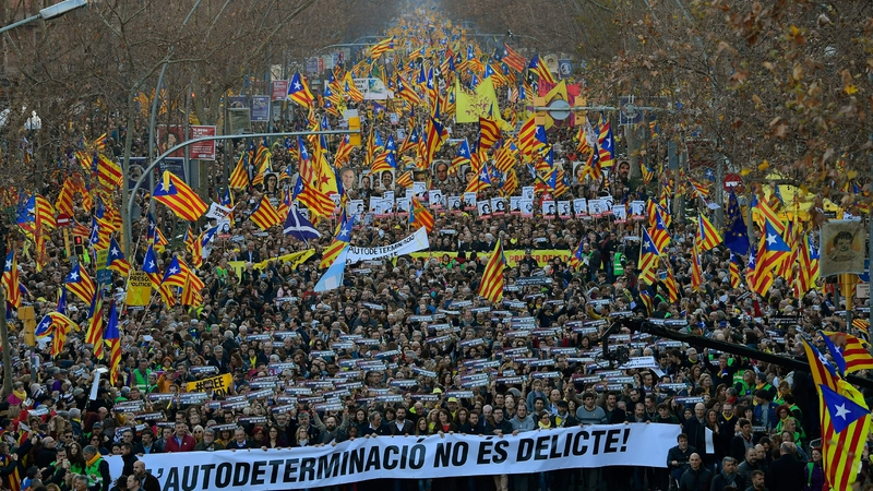 Demonstrators waved blue, red and yellow Catalan separatist flags and carried banners reading 'Freedom for political prisoners'