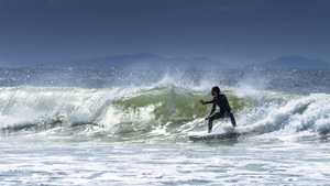 Belongil Beach in Byron Bay is popular with surfers and tourists