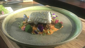 Steamed Hake with Chorizo Cassoulet and Red Pepper Sauce