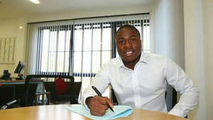 Michael Obafemi signing his new contract