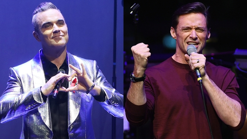 """Hugh Jackman is inviting Robbie Williams to be his guest because """"concerts should feel like something happened that night that couldn't happen anywhere else"""""""