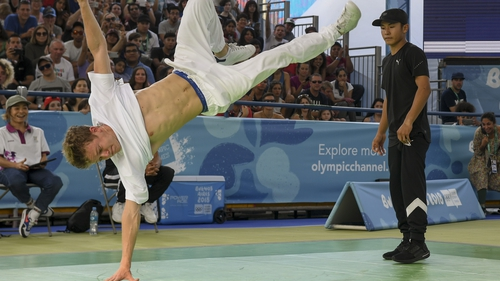 Russia's b-boy Bumblebee competes against Japan's b-boy Shigelix during a battle at the Youth Olympic Games in Buenos Aires