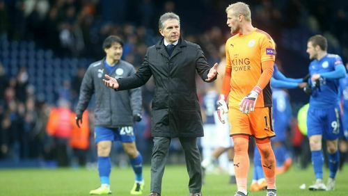 Puel (second from L) and Kasper Schmeichel having a chat