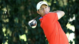 Rory McIlroy tees off on the 12th