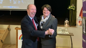 Arlene Foster and Shane Ross poss for photos in the hall used in the film Ballroom of Romance in Glenfarne