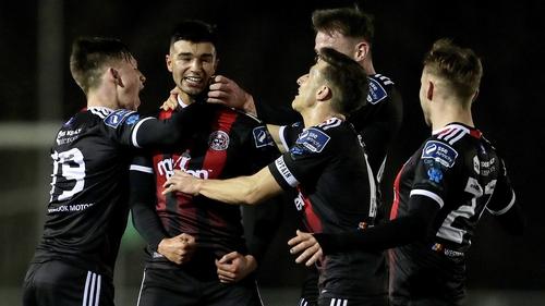 Danny Mandroiu celebrates scoring a goal with teammate
