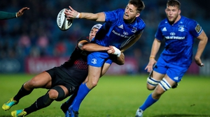 Ross Byrne offloads in the tackle