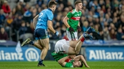 David Byrne of Dublin watches as Mayo's Brian Reape goes head over heels