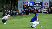 Johnson and McIlroy line up putts on the last