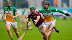 Offaly's Ben Conneely with Brian Concannon of Galway