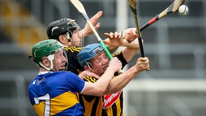 Kilkenny's John Donnelly and Walter Walsh rise with Robert Byrne