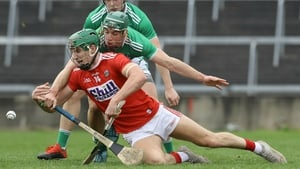 Limerick's Sean Finn and Aidan Walsh of Cork