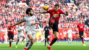 Victor Lindelof (R) in action against Liverpool