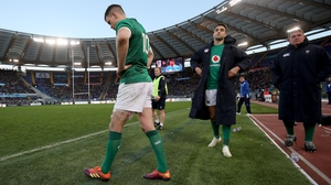 Johnny Sexton and Conor Murray at the end of Ireland's awkward 26-16 win over Italy in Rome